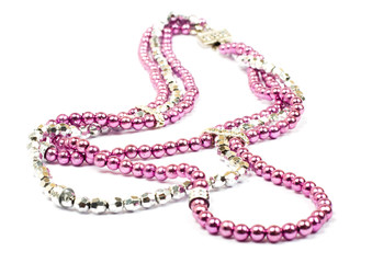 Pink plastic necklace on white background