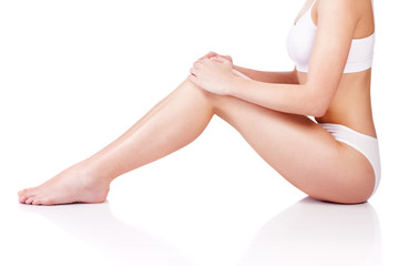 Legs and part of a female body, isolate on white background