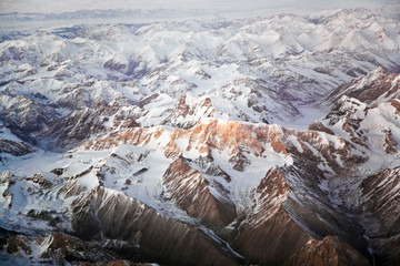 beautiful view from aircraft to snow covered mountains in asia