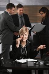 Receptionist receiving calls