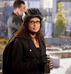 Businesswoman going to work by bike