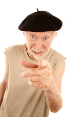 Unpleasant Senior Man in Black Beret Pointing at Camera