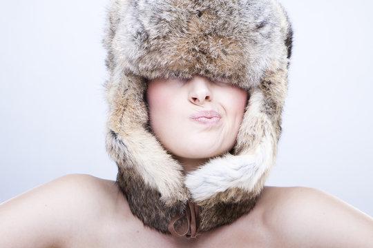 beautiful girl in a fur hat