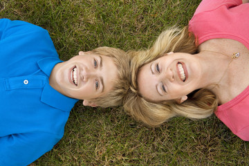 Mom and Son Lying in Grass