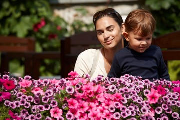 Child and mother outdoor in spring