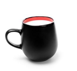 Black mug with milk