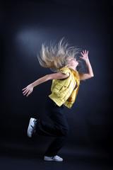 woman modern dancer against black background