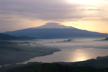 misty on lake and mount Etna