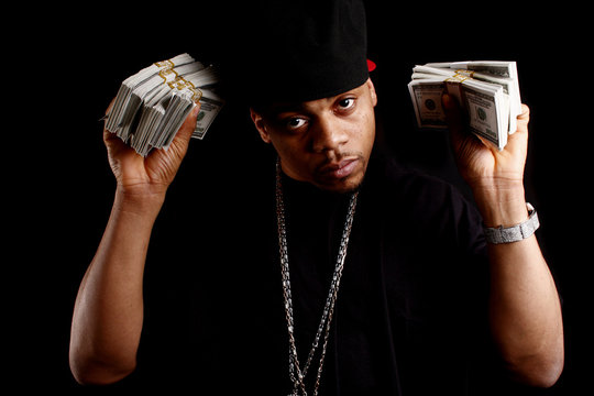 young black male with bundles of cash