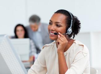 Positive businesswoman talking on headset