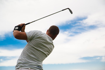 Golfer silhouette in swing pose