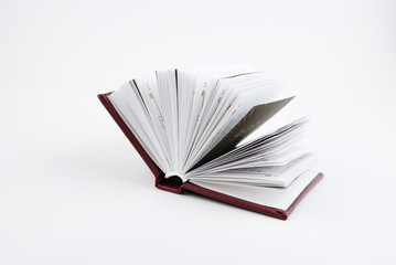 small open book on white background