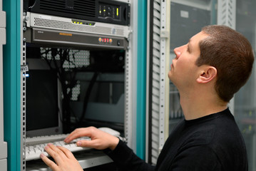 Network technician perform preventive maintenance to a server