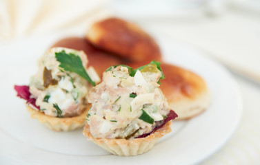 Appetizer in tartlets and patties on plate