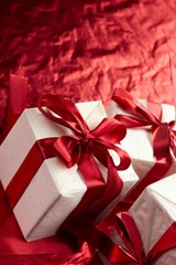 Beautiful gift boxes on the red background