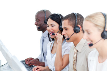 Laughing woman and her team working in a call center