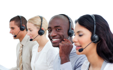 Attractive man and his team working in a call center