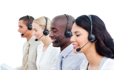 Positive business team working in a call center