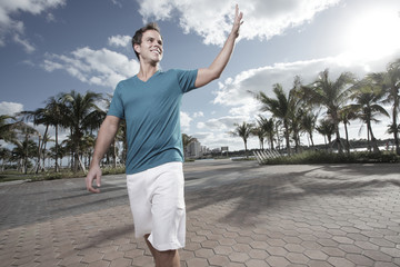 Man waving in the park