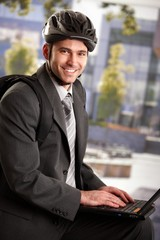 Businessman wearing bike helmet