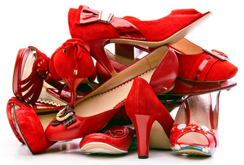Pile of female red shoes isolated on white background