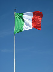 Waving Italian flag on natural sky