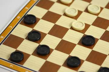 A game of checkers or draughts