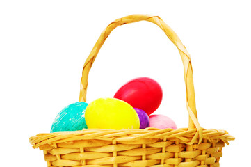 Easter concept with eggs and basket on white