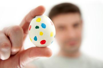 Man Holding a Spotty Easter Egg