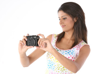 Teenage girl looking the digital camera