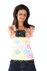 Beautiful girl with digital camera