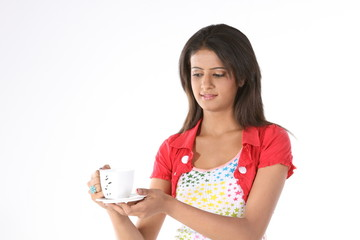 Young women holding coffee cup