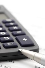 Calculator and pen close-up