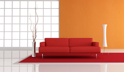 red leather sofa in fron of a orange plaster wall