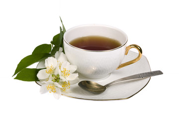 White cup of tea with jasmine flowers isolated on white