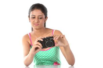 young beautiful girl with the camera