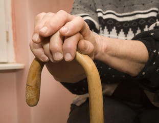 hands of old woman with stick
