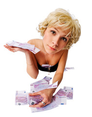 Blond girl with lots of cash on the floor
