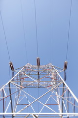 Power lines on a tower.