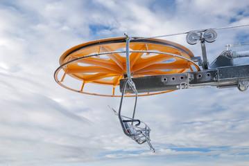 frozen chairlift with orange wheel