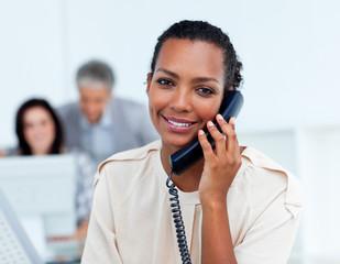 Charming businesswoman talking on phone