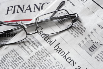 close up of a financial newspaper pages and headlines