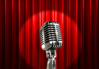 Silver microphone with red curtains