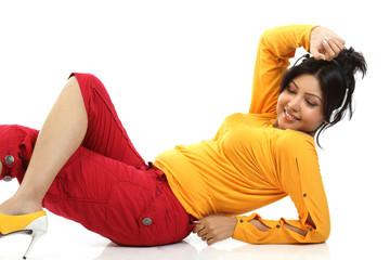 Chubby girl enjoying music lying on floor