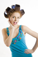 Young beautiful housewife in hair curlers
