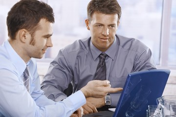 Businessmen working on laptop