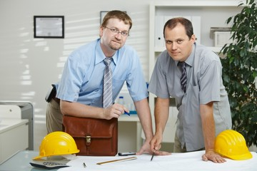 Architects working at office