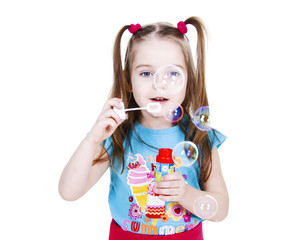 girl is blowing soapy bubbles isolated on white