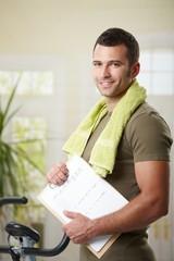 Man holding training plan