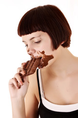 Young beautiful glutton eat chocolate isolated on white